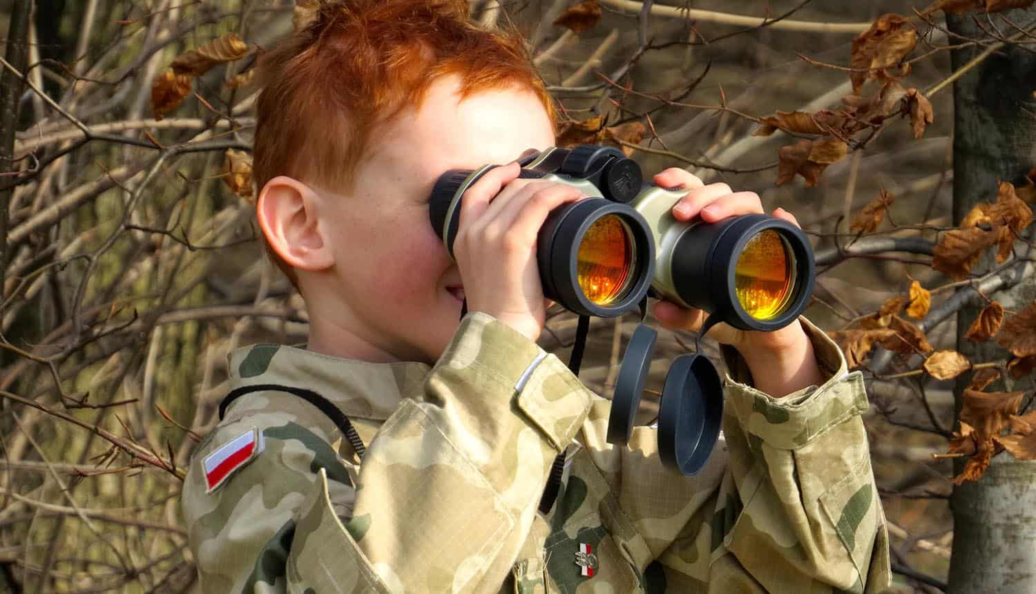 Image of boy using binoculars representing companies watching their data