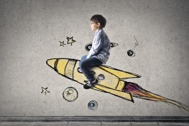 Image of boy sitting on imaginary rocket representing Australian privacy regulation hitting hyperdrive