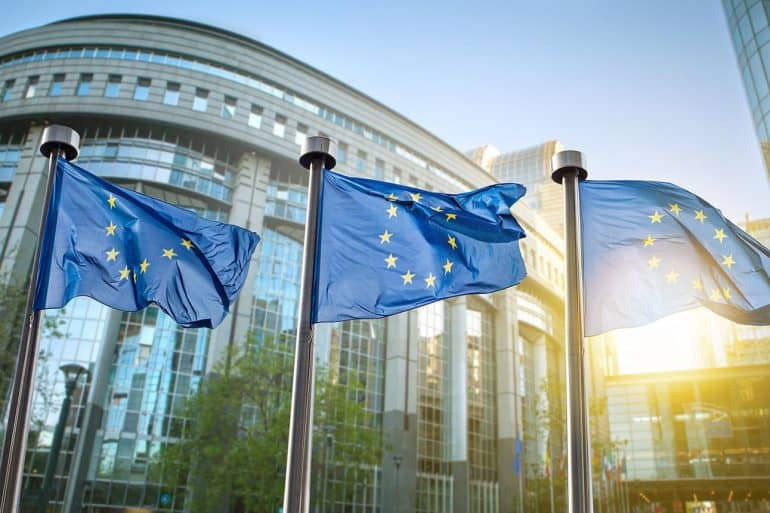 Image of EU flags in front of building representing European Union GDPR from an Asian perspective