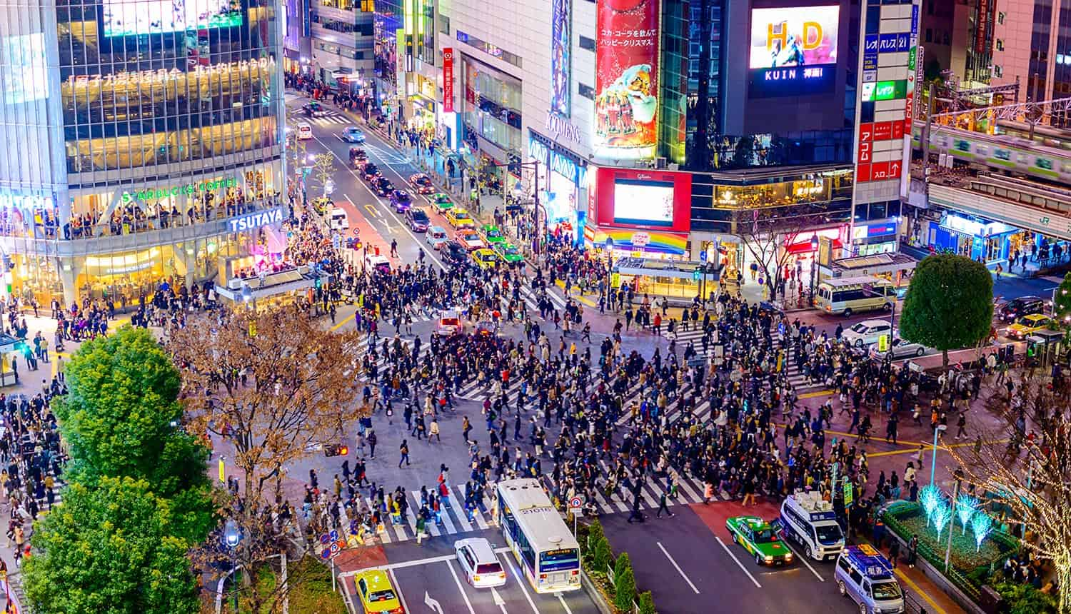 Image of crowd crossing a busy road junction representing the questionable actions by good organizations for the greater good