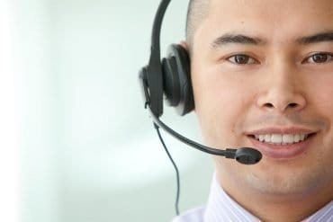 Image of call center agent with a headset representing the issues for direct marketing in Hong Kong