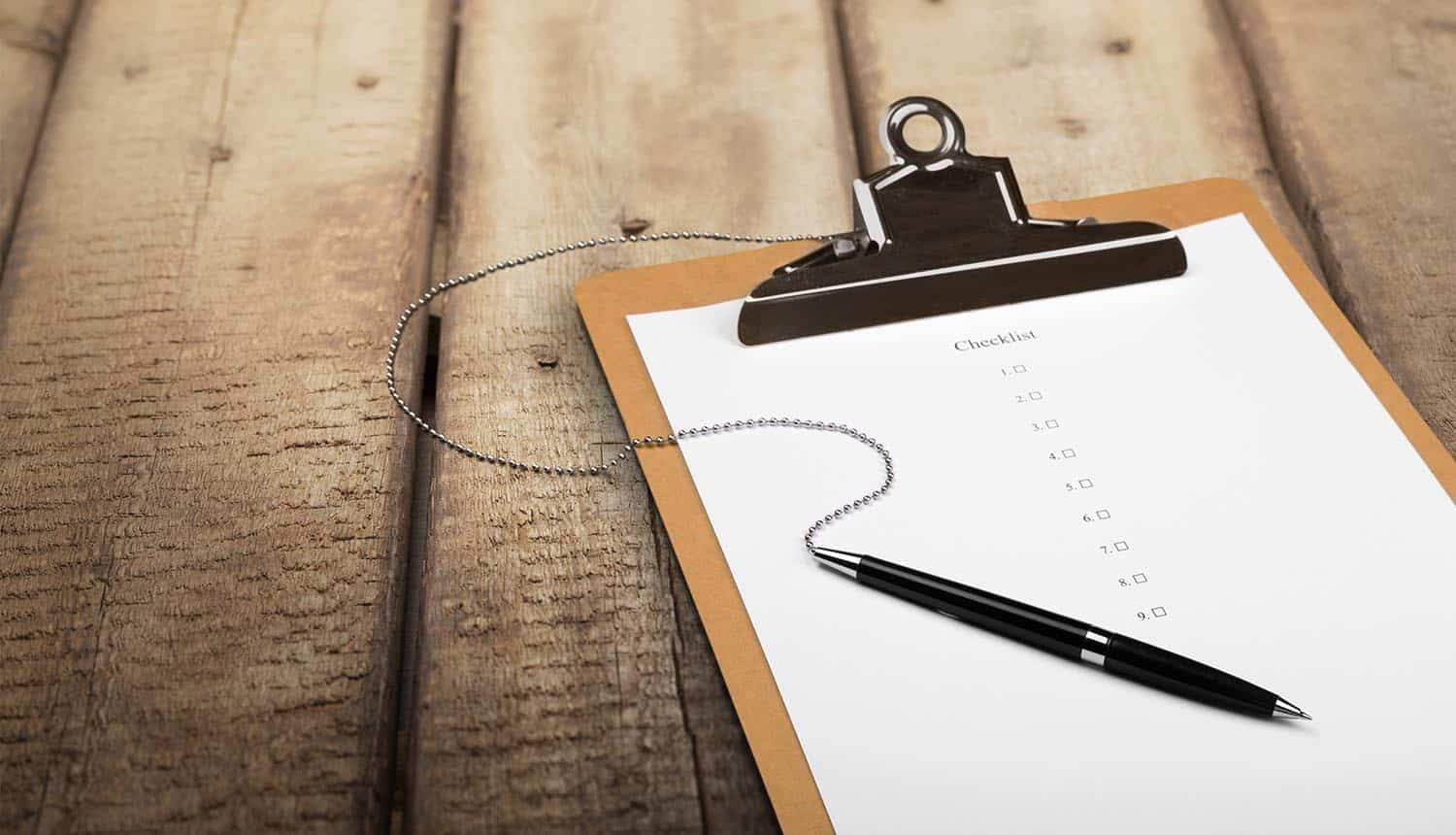 Image of checklist on a clipboard and pen representing the need to demonstrate compliance using an accountability approach
