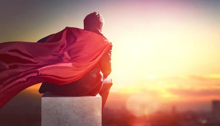 Image of businessman with cape looking at the sunrise signifying the rise of the chief security and privacy officer