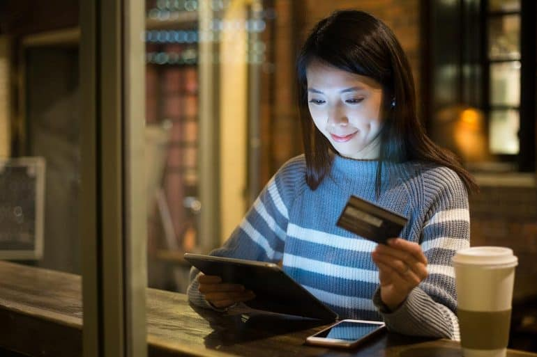 Image of woman using credit card for online shopping representing the season for cyber attack