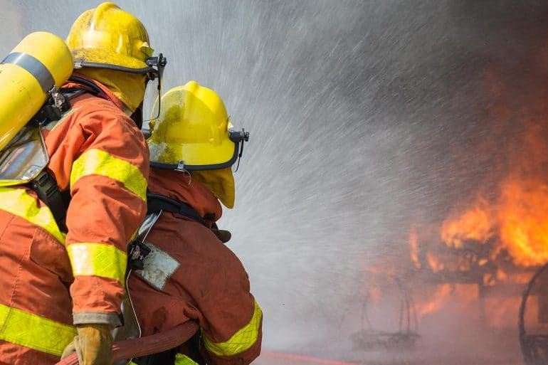 Image of firemen putting out a fire representing data breach response