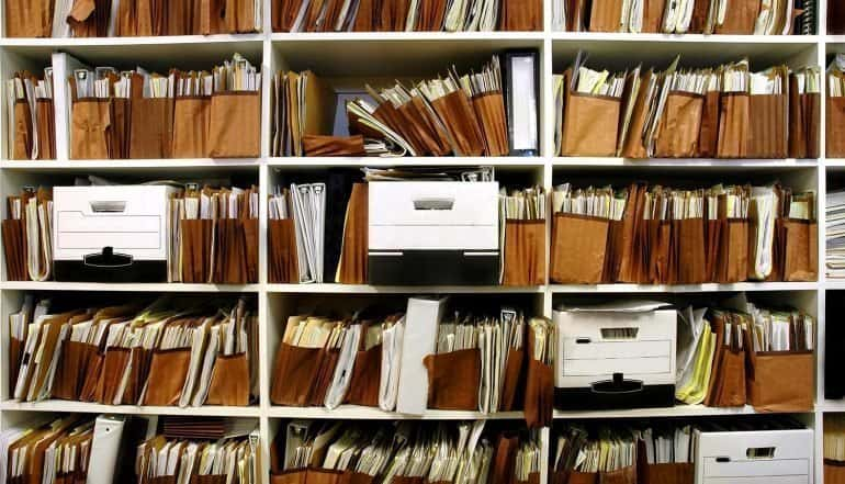 Image of shelves of boxes and files representing the data privacy challenges of knowing their data for IT leaders