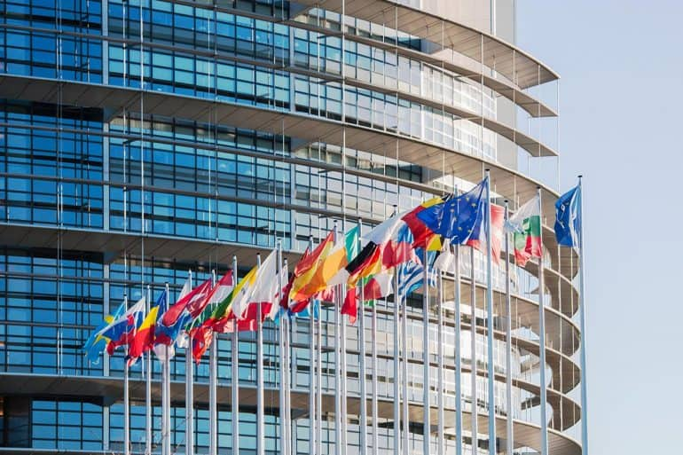 Image of EU country flags in front of building representing the new EU General Data Protection Regulation