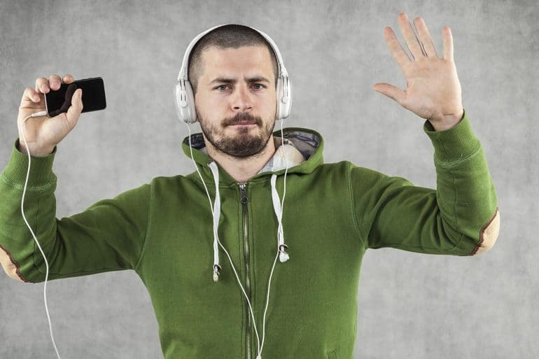 Image of man wearing headphones and arms raised representing the privacy infringement claim on Bose
