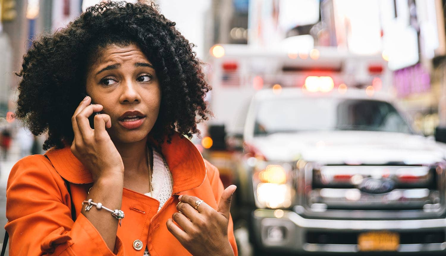 Image of distressed woman speaking on mobile phone with ambulance in the background representing changes in privacy law in Australia regarding breach reporting, big data and the new EU GDPR