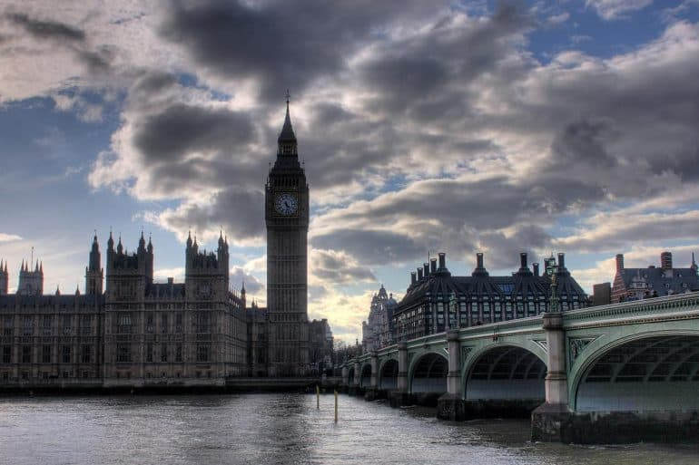 Image of UK parliament building against a dark cloudy sky representing the use of big data in politics