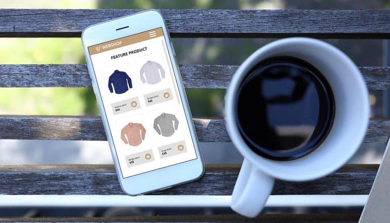 Image of mobile phone with shopping screen and coffee cup representing privacy in mobile advertising
