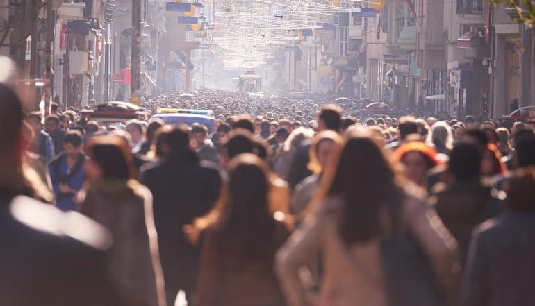 Image of crowded street with blurred faces representing how privacy and anonymity can be achieved in the age of big data