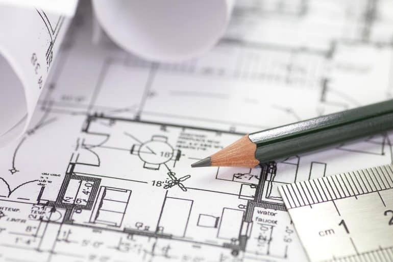 Image of pencil and ruler on a architect plan drawing representing how international standards can be used for privacy and security