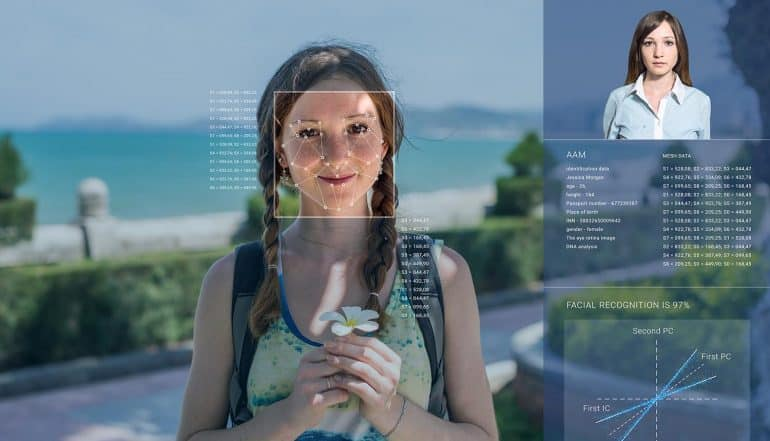 Image of woman being identified by facial recognition technology representing how data privacy and security concerns will be addressed by emerging technologies