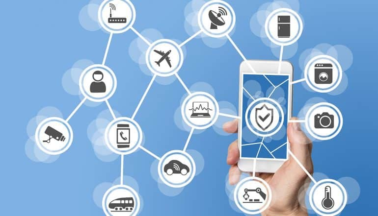 Image of mobile phone with protected icon and surrounded by devices representing how IoT security and privacy is tackled by the updated NIST 800-53