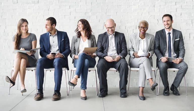 Image of people sitting in chairs waiting for interview signifying rise in GDPR jobs as compliance deadline looms