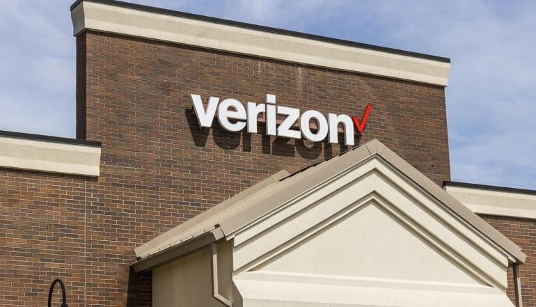 Image of Verizon logo on a building wall representing how the Verizon Up program wants your privacy in return for rewards and targeted ads