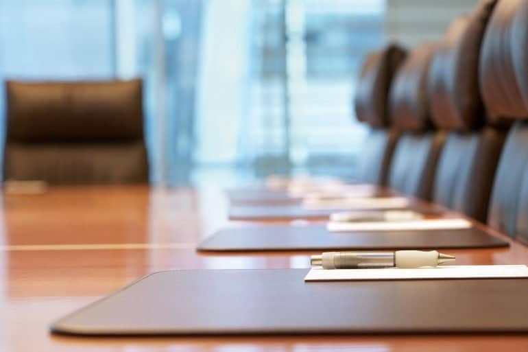 Image of empty boardroom signifying how in terms of board agenda, data breach reporting has been overtaken by privacy governance