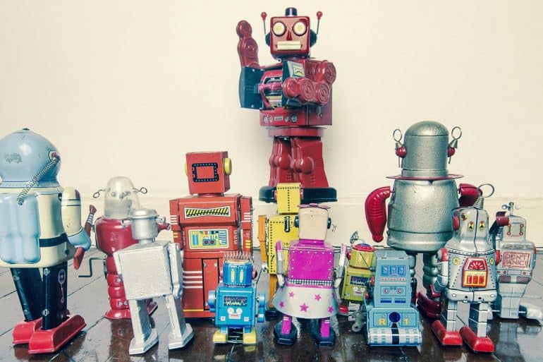 Image of robot leader commanding a group of robots signifying how IoT botnet using DDoS attack can cripple the entire internet