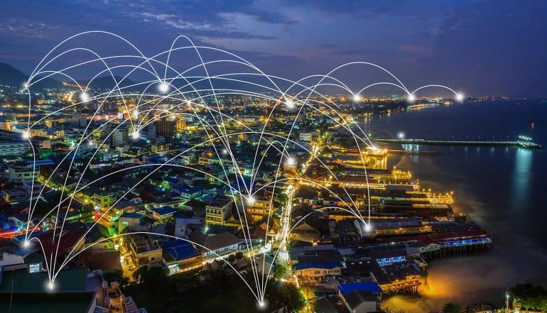 Image of city at night with lighted network connections signifying the danger of the latest WPA2 Wi-Fi security flaw