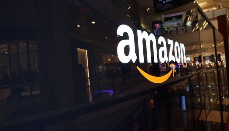 Image of Amazon logo on a shop window signifying the hacking and insurance risks issues for Amazon Key