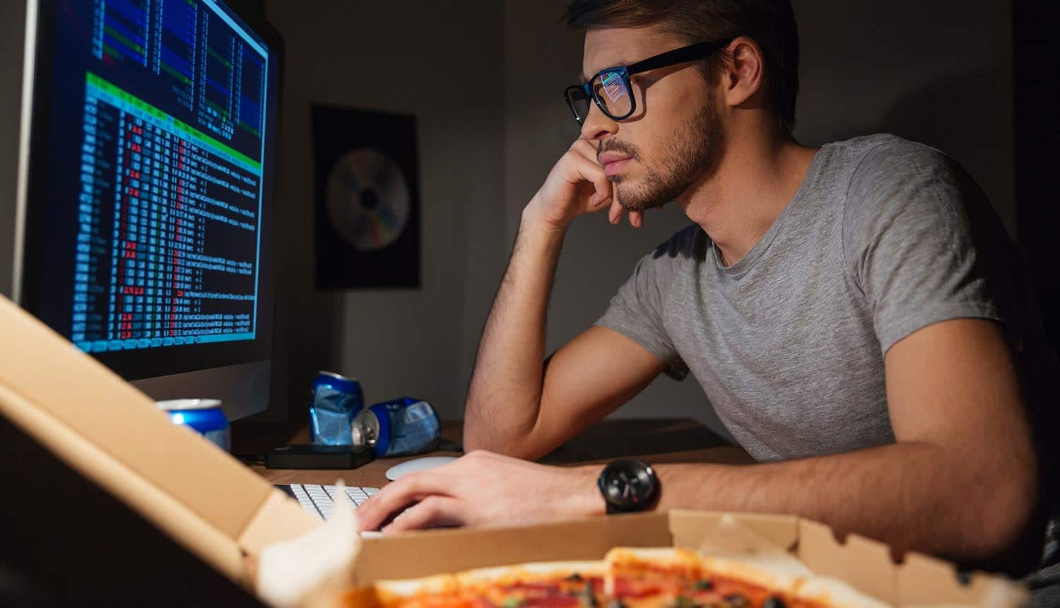 Image of developer in front of screen writing secure code code