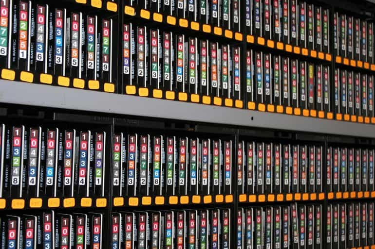 Image showing rows of data tapes representing U.S. government revealing vulnerabilities equities process