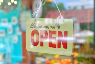 Image of a open sign on shop window representing how the end of net neutrality and the open internet will impact data privacy and cyber security