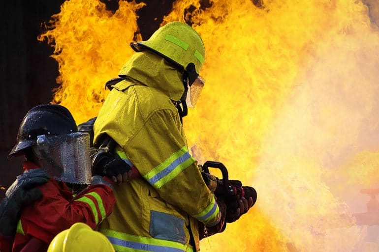 Image of firemen putting out a fire representing cyber incident response