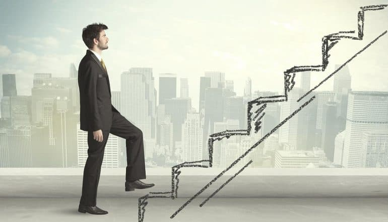 Image of business executive walking up stairs representing steps for security experts to gain privacy perspective, from CISO to CPO