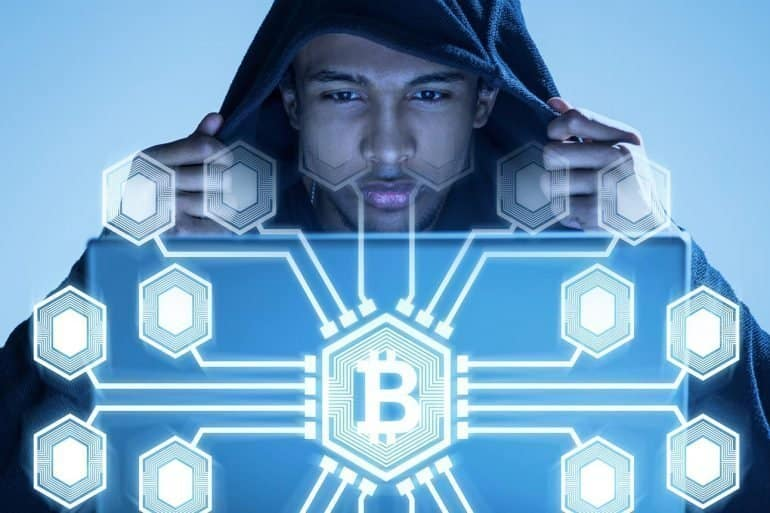 Image showing man in hood watching futuristic screen and cryptojacking Coinhive for Monero