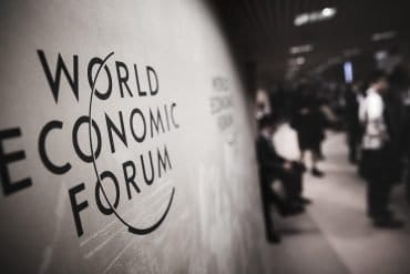 Image of World Economic Forum (WEF) at a conference in Davos and the discussion of security and AI