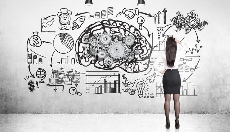 Image of woman standing in front of a walll with a brain and plans signifying the privacy challenge of artificial intelligence