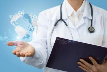 Image of woman with stethoscope and holding a report and connected globe signifying the internet health report with critical issues of Big Tech, fake news and IoT security