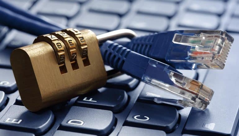 Image of lock on network cables on top of keyboard showing need for network security