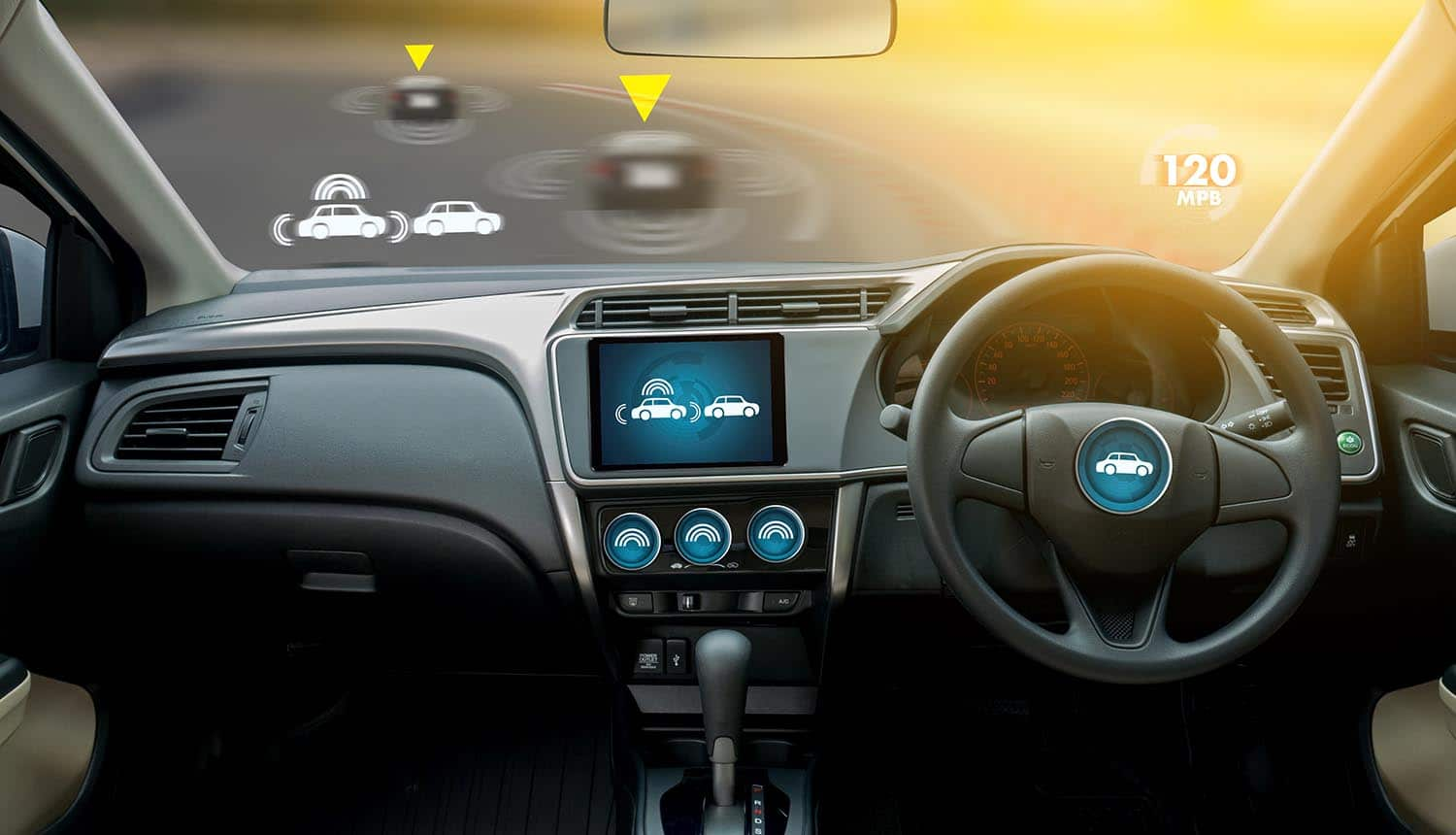 Image of self-driving connected vehicles with no cummuter in the driving seat signifying no one in control of privacy