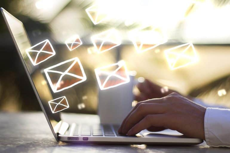 Image of man with laptop and email