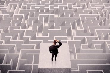 Image of security pros standing in front of a maze and wondering how clueless governments can handle social media regulation