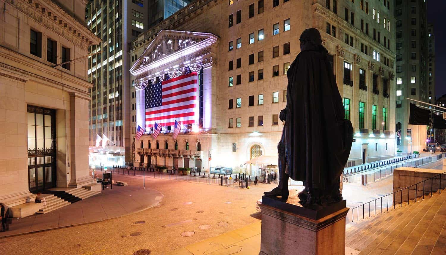 Intersection of Broad Street and Wall Street showing the George Washington Statue overlooking the New York Stock Exchange
