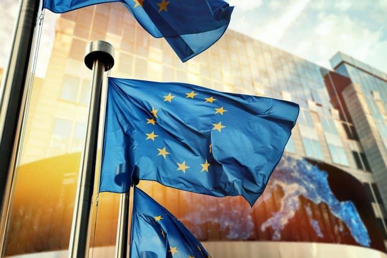 EU flags waving in front of European Parliament building