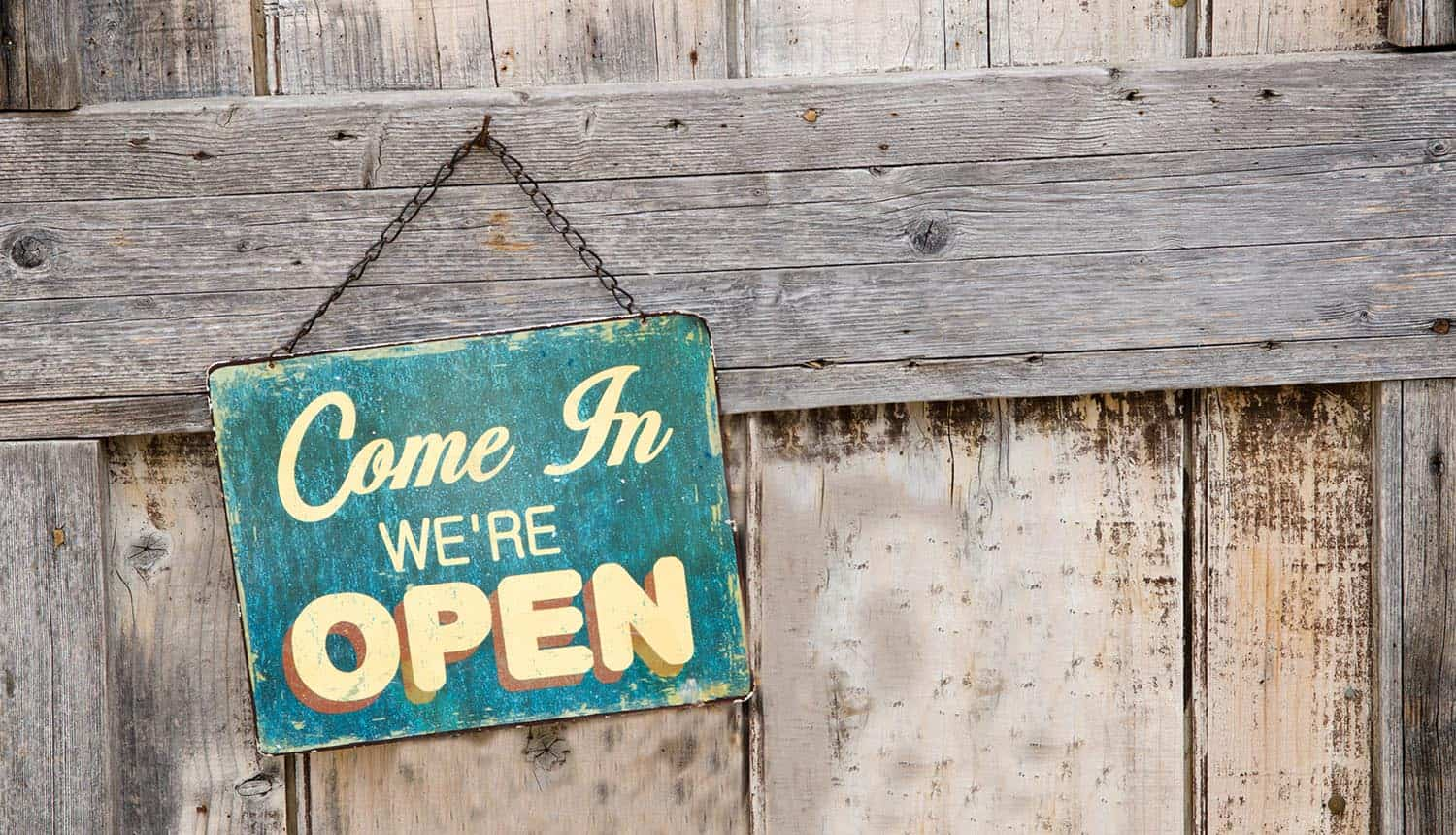 Vintage open sign on old wooden door showing the need for data transparency for customer loyalty