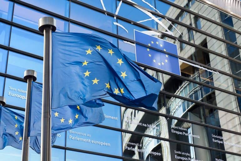European Union flags in front of the European Parliament showing catch 22 of the GDPR
