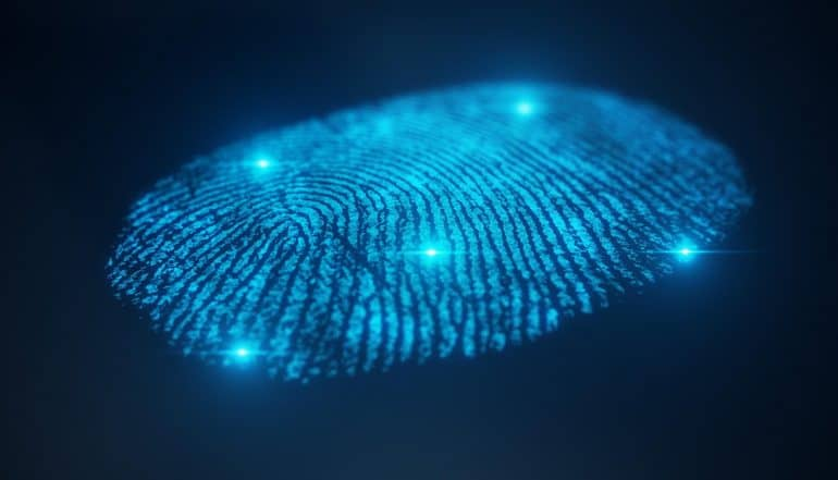 Fingerprint scan provides security access with biometrics identification showing push for national digital ID system