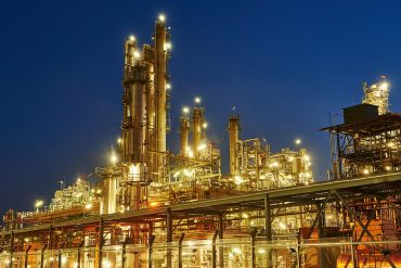 Oil refinery plant of petroleum showing critical infrastructure facing increasing cybersecurity regulations