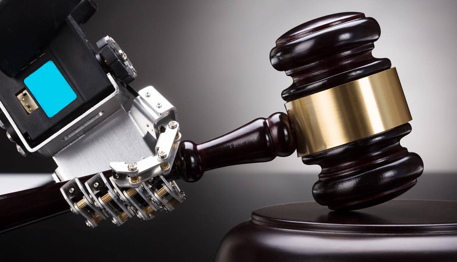 Robot's Hand Striking Gavel on Sounding Block Showing Tech Industry Push for a Federal Privacy Law