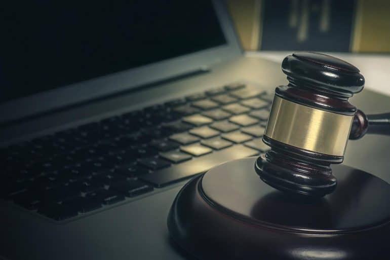 Hammer and gavel in front of laptop showing tightening of data breach notification laws