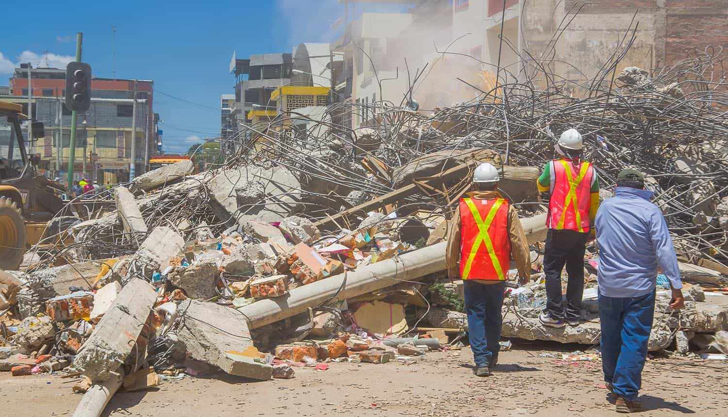 Rescue team making recovery efforts after earthquake showing importance of data recovery and protection planning
