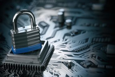 Padlock on computer circuit board showing threat of ransomware attacks
