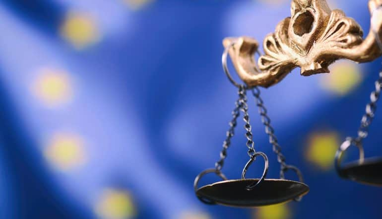 Justitia, Lady Justice in front of the European Union flag in the background showing the impact of Europe's new cookie regulations