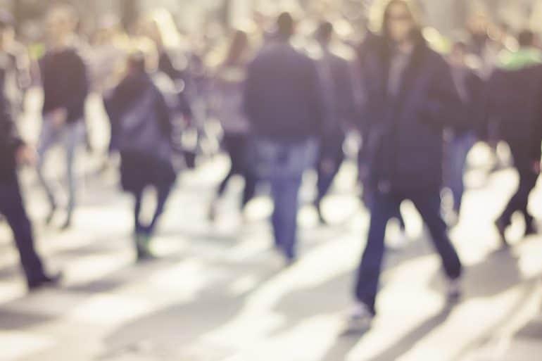 Blurred pedestrians in modern city street